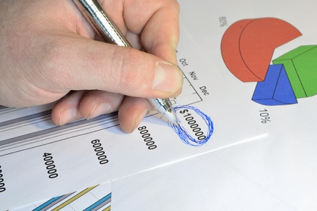billion: Business background with graph, pen and hand. Stock Photo