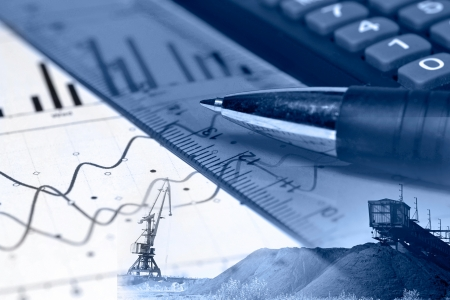 coal mining: Business background with graph, ruler, pen and calculator, in blues.