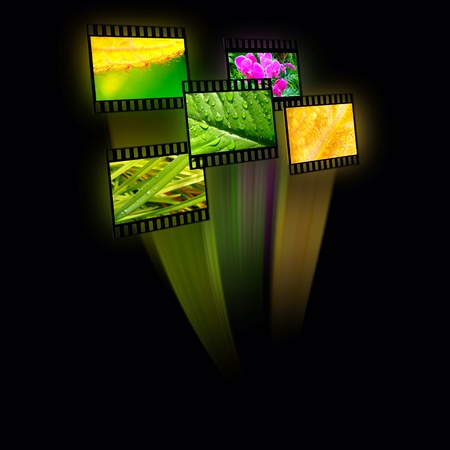 Film frames with color pictures (nature) on black background. photo