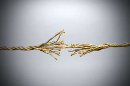 Broken rope on grey background. Stock Photo - 12602969