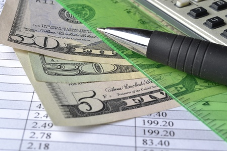 Business background with table, money and pen. photo