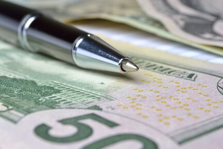 Business background with table, coins and pen. Stock Photo - 13044054