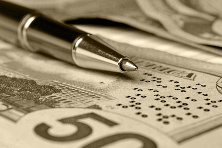 Business background with money, coins and pen, in sepia. Stock Photo - 13070315