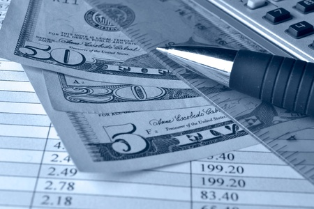 Business background with table, money and pen  photo