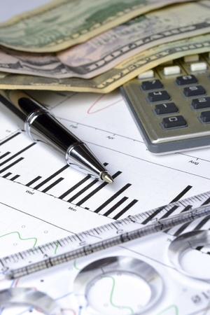 Business background with graph, coins and pen. Stock Photo - 13123208