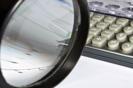 Business background with magnifier, ruler and calculator. Stock Photo - 13250241