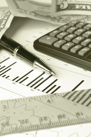 Business background with chart, coins and pen, in sepia. Stock Photo - 13572371
