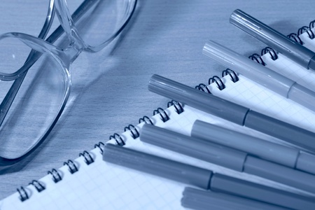 soft tip pen: Business background with glasses, ruler, pen and notebook. Stock Photo