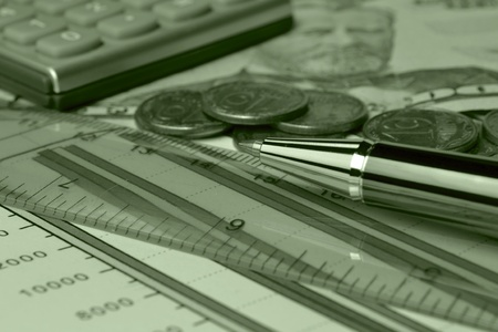 Business background in greens with table, note, coins and pen, in sepia. Stock Photo - 13900190