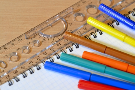 soft tip pen: Business background with ruler, pens and notebook.