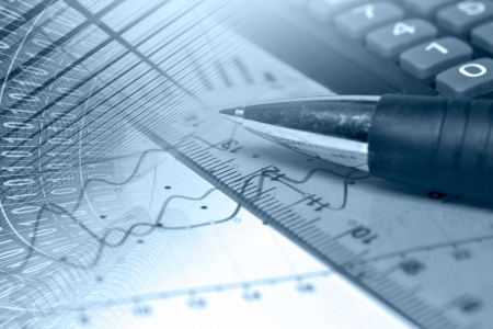 Business background in blues with graph, ruler and pen. Stock Photo