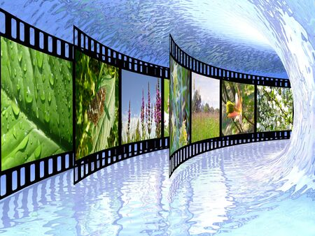 Film rolls with color pictures (nature) in the blue tunnel. photo