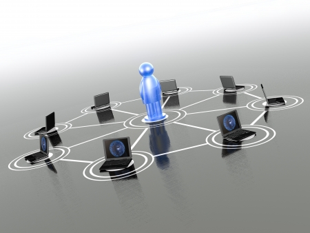 Network - man and laptops on grey background. Stock Photo - 17234517