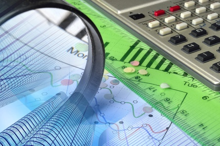 Business background with graph, magnifier and calculator.