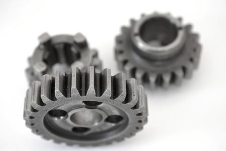 metall: Three metal gears on the white background. Stock Photo