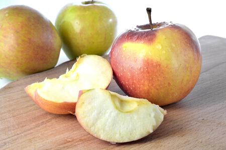 malnutrition: Apples on the desk on white background.