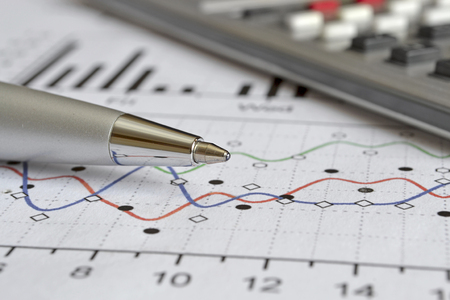 efficacy: Business background with graph, pen and calculator. Stock Photo