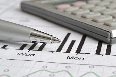 effectiveness: Business background with graph, pen and calculator. Stock Photo