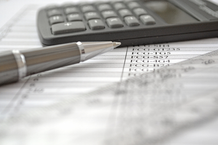 efficacy: Business background with table, ruler, pen and calculator.