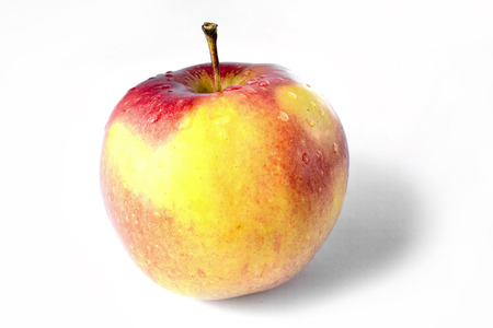 malnutrition: Yellow and red apple on the white background. Stock Photo