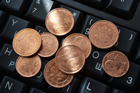 accumulate: Money with keyboard - abstract business background. Stock Photo
