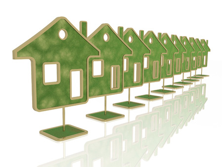 Green homes on white reflection background. Stock Photo