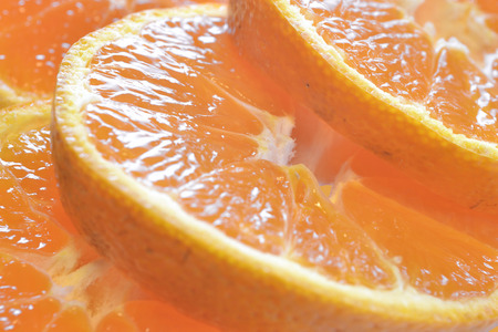 malnutrition: Orange slices as food background. Stock Photo