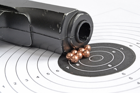 airgun: Airgun and bullets on the target background. Stock Photo