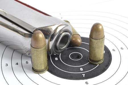 Pistol, target and ammunition on the white background.