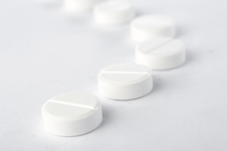 Tablets on white - abstract medical background. Stock fotó