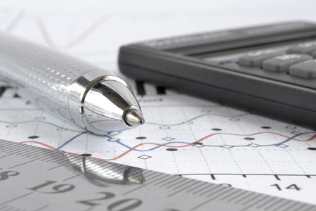 Business background graph, ruler and calculator.