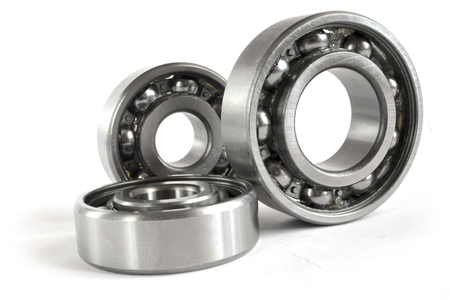 Three close-up bearings on the white background. Imagens - 119844550