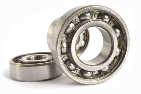 Three close-up bearings on the white background.