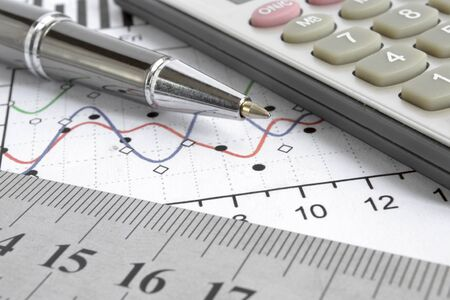 Business background graph, ruler and calculator. Stock fotó - 130160446