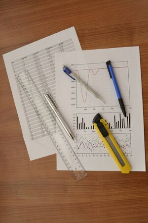 Business background graph, ruler and pen on the table. Stockfoto