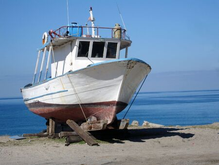 fishingboat: old fishing-boat to the drift
