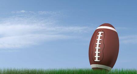 terrain foot: Football am�ricain sur l'herbe sur fond de ciel bleu-rendu