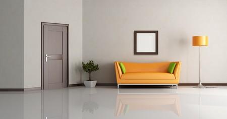 modern living room with orange couch and wooden door - rendering Stock Photo