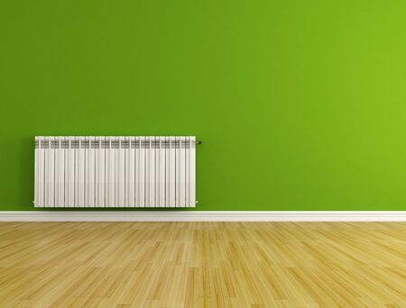 green empty room with hot water radiator - rendering Stock Photo