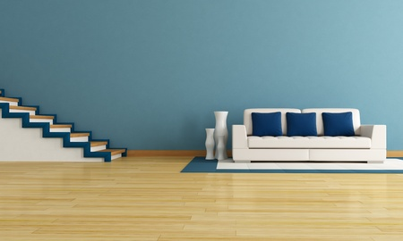 blue living room with staircase and modern white couch photo