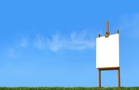 artist easel with blank canvas on grass in a sunny day - rendering - the sky on background is amy photo Stock Photo - 9876336