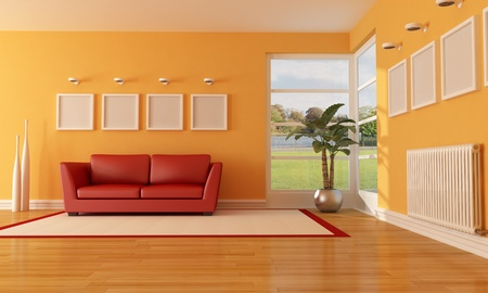 radiador: naranja y rojo moderno Salón con sofá y procesamiento de radiador - la imagen de fondo es un mi foto Foto de archivo