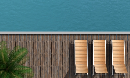 deckchair: top view of  a boardwalk with three beach chair and palm tree Stock Photo