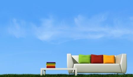 divano: divano bianco con cuscino colorato su erba contro il cielo blu - rendering Archivio Fotografico