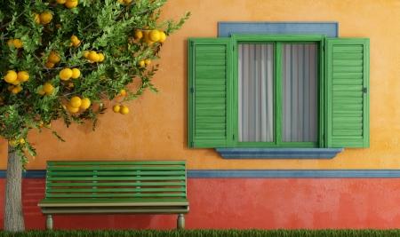 Colorido casa vieja con la ventana de madera y banco verde - representación