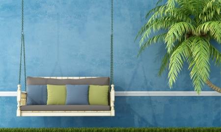 columpio: Columpio de madera Vintage en el jard�n contra la pared azul - representaci�n