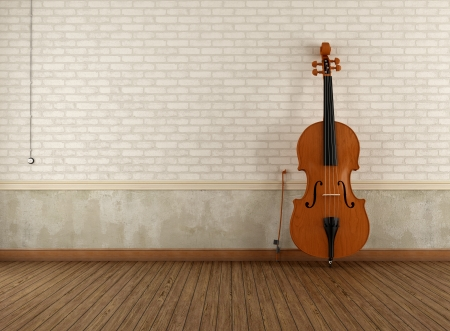 Double-bass  leaning against a brick wall in an empty room Stock Photo - 23330251
