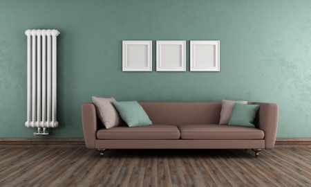 Vintage living room with elegant sofa and classic radiator on wall  photo