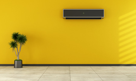 room air: Yellow empty room with black air conditioner on wall - rendering Stock Photo