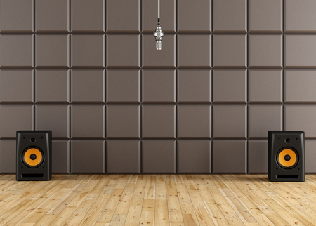 Professional microphone in a recording studio with brown acoustic panel speaker and wooden floor - rendering photo